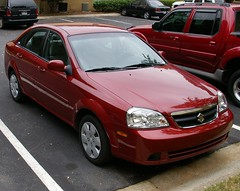 Suzuki Forenza or a Daewoo Nubira or is it a Chevy Lacetti! (Andrew Scorgie) Tags: red chevrolet car rental daewoo suzuki forenza nubera lecetti