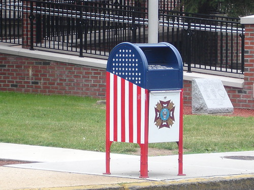 Postal drop-box in Newark, New Jersey USA painted in the colors and design of the American Flag, with patriotic designs