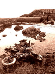 Careless Act (Ashwa Faheem ( avva )) Tags: beach water sepia toys flickr sad stones bikes bicycles tsunami damage trips maldives corals careless humanerror thrownout tsunamidamage maldivians avva theunforgettablepictures vilingilli