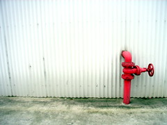 lonely vigil (badjonni) Tags: red colour wall hydrant fire grey minimalism corrugated