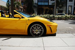 Ferrari F430 Spyder parked on Rodeo Drive in Beverly Hills (j.hietter) Tags: california sun detail tree beautiful car yellow italian bright gorgeous vivid ferrari spyder palm hills part exotic beverly partial f430