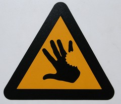They bite! (tommyajohansson) Tags: 15fav black london sign yellow warning hand bite faved tommyajohansson