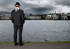 Facing the wrong way ? (oskarpall) Tags: face businessman iceland back pond front reykjavik oskar suit backwards sland facing andri tjrnin supershot bakcside skipio