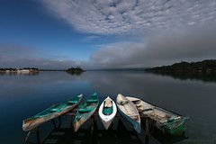 Old Canoes at Flores, Guatemala (PolarPhoto.ca) Tags: lake flores boats guatemala soe ultrawideangle blueribbonwinner 100commentgroup 100commentsgroup bestcapturesaoi coth5 newgoldenseal mygearandmepremium mygearandmesilver flickrawardgallery