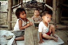 Mekong village (Linda DV) Tags: travel people cute barn children geotagged kid asia southeastasia child young culture kind 1998 criana laos enfant nio dziecko bambino    lapsi copil dijete  dt    lindadevolder  photonegativescan