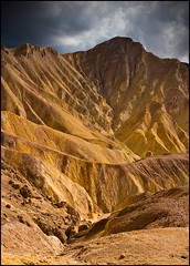 Vivid Golden Canyon (realkuhl) Tags: california copyright john all  rights deathvalley reserved facebook dramaticclouds lehmkuhl landscapephotograph realkuhl itrainedthenightbefore in2hoursitwillberainingagaind johnlehmkuhlcopyright2007allrightsreserved