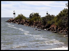 Lighthouse (missgingersnap) Tags: trees sky lighthouse lake water rocks waves