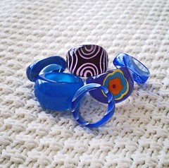 A Jumble of Blue (Enchanticals ~I'm Coming Back) Tags: pink blue red 6 black flower geometric floral fashion yellow fun costume big mod hand dynamic finger group shapes blues jewelry collection plastic rings pile dome round multiples opaque translucent swirls resin digits six flowerpower striped eyecandy bold jumble costumejewelry lightweight geometricpatterns enchanticals enchanticalsetsy stripescircle