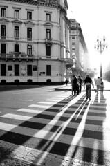 long shadows in b&w (micmol ) Tags: street plaza shadow people woman man love argentina sign vertical loving america port de movement hugging buenosaires hug couple jay crossing floor ar respect buenos aires walk south capital group diagonal together shade destination mayo care migration federal brace backlighting norte bsas posterity