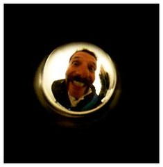 Through The Peephole (Gem Trem) Tags: door morning portrait abstract man male men eye art smile wales fun funny comedy university phone sam creepy fisheye odd newport spy laugh grin mad peephole spying peeping iphone caerleon samcornwell iphoneography redbullhead gemmatremlett