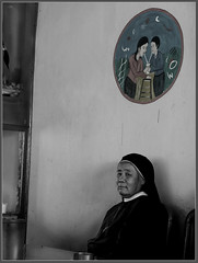 A lonely nun in a resturant of a tourist spot - by Sukanto Debnath