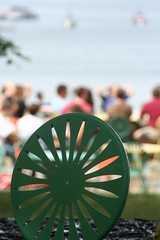 Green sunburst chair (slambo_42) Tags: wisconsin chair dof bokeh terrace madison sunburst mendota wi catchycolorsgreen flickrbeer twtmeispy mfm0055 madisonaz