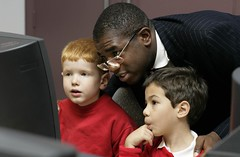 Culture Minister David Lammy tries out the new web site with some help form Alistair (on left) from St George The Martyre School and his friend.