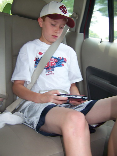 100619 in car 02 - Spencer playing video game