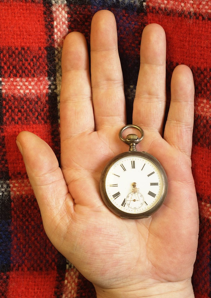 A pocket watch in my left hand
