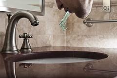 236:365 - Rinse, repeat. (Caleb Kerr) Tags: selfportrait motion reflection water bathroom sink scope spit clean faucet granite 365 liquid spew mouthwash listerine project365 strobist frozenaction elinchromskyport