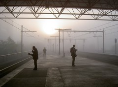 Commuting in the fog 1 (Art Rock (Hennie)) Tags: topf25 netherlands station fog topf50 topf75 topf100 almere peopleschoice thebigone blueribbonwinner cotcmostfavorited supershot artrock2006 fivestarsgallery superaplus aplusphoto favemegroup3 diamondclassphotographer flickrdiamond excellentphotographerawards theunforgettablepictures platinumheartaward artlegacy bwartaward world100f hennieschaper hennieschapertop100