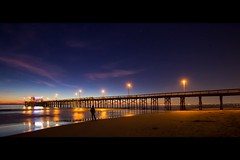 standing between the lights (Eric 5D Mark III) Tags: california light sunset sky people cloud selfportrait seascape color reflection beach night canon landscape star pier twilight eric atmosphere newportbeach backside orangecounty tone ef1635mmf28liiusm eos5dmarkii