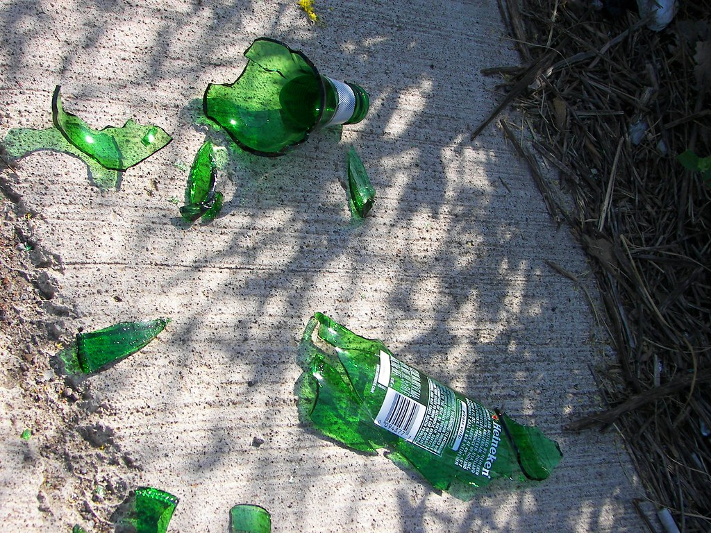 The broken green glass of a Heineken bottle in Toledo, OH