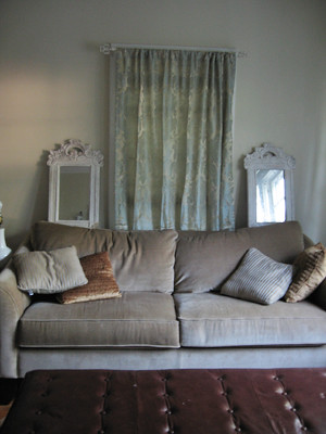 Single panel curtain behind couch