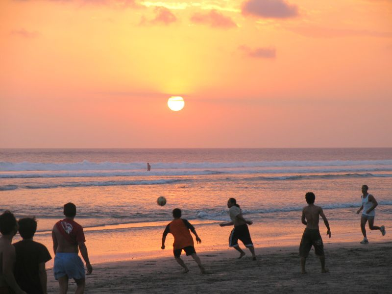 Kids playing soccer on Seminyak beach