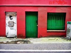 door 7 (tim caynes) Tags: street door city uk red urban woman building green window wall geotagged graffiti doors head lock path decay painted sony norfolk norwich grille padlock locked w1 crusty damp whiteline ithink fdf greenonred flickrfly timcaynes caynes magdalenstreet apehome geo:lat=5263535906448831 geo:lon=1296102528348765 ge:tilt=2174954274818397e10 ge:head=00001847228779424901 ge:range=2959702474741717