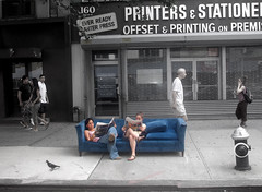 Lazing on a sunday afternoon (noamgalai) Tags: street new york nyc people ny newyork bird walking photography reading photo newspaper sitting newspapers picture queen read couch photograph printing sit stationery seated allrightsreserved printers globalvillage offset   photomania   noamg   noamgalai    globalcity  lazingonasundayafternoon invitedphotosonly gvadminshalloffame itsabeautifulgv wwwnoamgalaicom