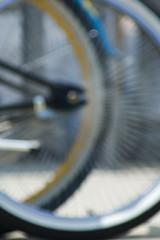 Beach bike bokeh B (Light Orchard) Tags: blue summer sun abstract art beach bike bicycle wheel yellow festival fun gold golden virginia focus bokeh spokes arts tire boardwalk leisure rim allrightsreserved donotusewithoutpermission 2010bruceschneiderlightorchard