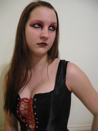 red portrait black goth corset laceup