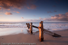 Old Groynes (Rob Ferrol) Tags: sea sky cloud art beach nature water sunrise canon point outdoors coast countryside solitude quiet shadows head yorkshire fine rusty sigma pebbles textures prints bolts 1020 groynes spurn 40d