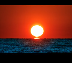 If it were only a mirage (Fort Photo) Tags: ocean sunset sun sol beach gulfofmexico nature water landscape solar nikon gulf florida dusk atmosphere astronomy atmospheric pensacola pensacolabeach 2010 optics d300 inferiormirage mywinners etruscanvasestage