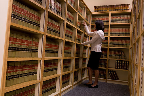 Paralegal at Work. Paralegals spend time in libraries, where they perform