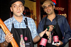 Luis da Silva (left), manager of Jules Bistro on St. Marks, and co-worker show off their selection of Beaujolais Nouveau 2010