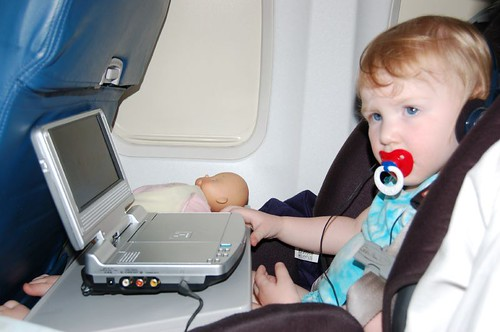 Leda watching Dora on a Plane!