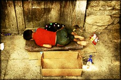 poverty. (-calexico) Tags: poverty camera blue boy sleeping red portrait money hot green colors yellow nikon europe sleep homeless nikond50 beggar future kosova kosovo begging peja calexico youngboy stricken nofuture kosov rugova rugov pej trimkabashi lackofmoney