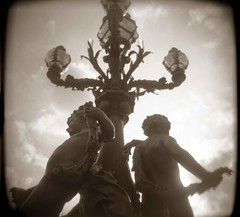 Pont Alexandre Boys (happygrrl) Tags: bridge vacation paris france 120 lamp sepia clouds holga europe toycamera statues ishootfilm squareformat pontalexandre pontalexandreiii