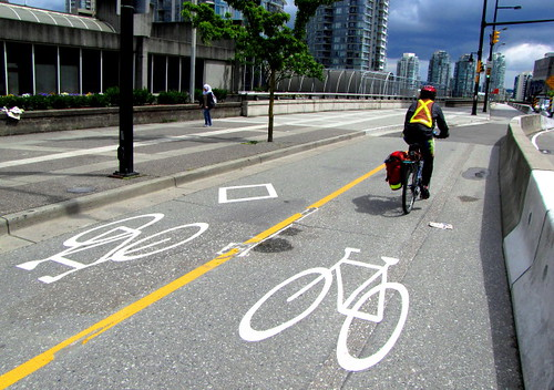 Cyclist on Vancouver's Dunsmuir Bike Lane at Georgia Viaduct
