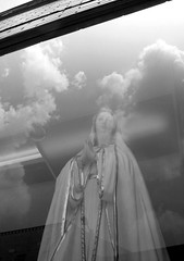 Our Lady of Passyunk Avenue (James Mundie) Tags: blackandwhite bw black reflection blancoynegro monochrome noir monochromatic shopwindow virginmary biancoenero southphiladelphia southphilly blancetnoir philadelphiapa mundie schwarzweis copyrightprotected jamesmundie eastpassyunkavenue jamesgmundie profjasmundie jimmundie fixedshadows copyrightjamesgmundieallrightsreserved