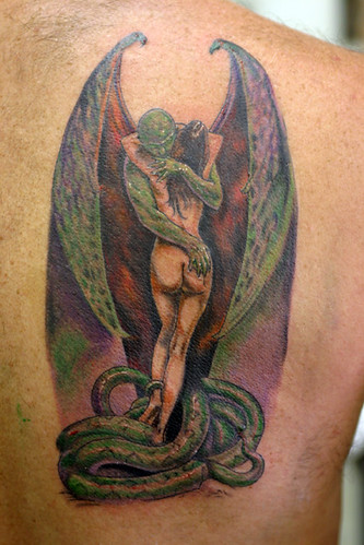 Angel vs She devil devil demon and girl Tattoo by The Tattoo Studio.