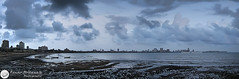 Panorama - South Mumbai, India ( Rizwan Mithawala) Tags: blue sea people panorama india beach silhouette skyline architecture clouds canon boats evening coast rocks cityscape photographer pano towers hilton dramatic surreal taj shore bombay gateway maharashtra ambassador operahouse mumbai drama vt oberoi airindia cst chowpatty southmumbai arabiansea colaba rizwan narimanpoint chowpattybeach ncpa girgaum navynagar saifeehospital panchratna rizwanmithawala mithawala 803to804