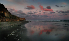 Twilight and the Cliffs of Kai Iwi Beach (Peter Kurdulija) Tags: ocean new pink blue sunset sea sky cliff cloud reflection beach nature beauty plane canon landscape island coast twilight sand scenery pacific north wave powershot zealand kai 10000 wanganui splendor iwi kurdulija a550 nukumary