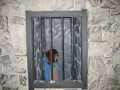 jail cell window with woman inside