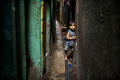 Curious in Mumbai (mitchellk81) Tags: life street city light india texture youth children child corridor streetphotography streetlife shy curious mumbai narrowstreet colaba indiansubcontinent