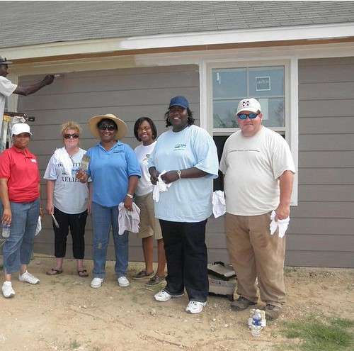 Mississippi Rural Development State Director Trina George (second from right) and a crew of USDA Rural Development employees pose in front of an almost completed wall. The crew was part of a team of painters helping to repair and repaint a Yazoo City home damaged by the recent tornado.