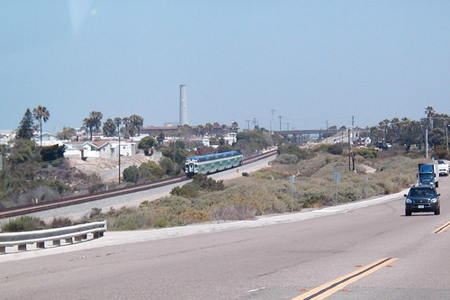 A southbound commuter train approaches Poinsettia station in Carlsbad, California