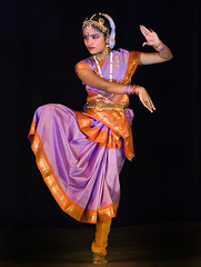 Bharatnatyam (Divs Sejpal) Tags: light red orange woman india colors girl lady pose dance colorful colours traditional expressions magenta clothes ornaments colourful tradition gujarat bharatnatyam bharatanatyam mudra divs divyesh intrestingness flickrexplore explored ahmedebad sejpal