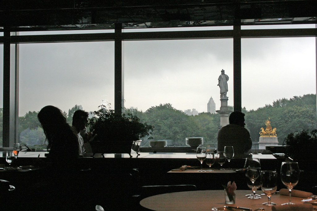 Silhouettes of a female diner and chefs