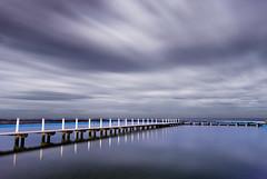 Waiting For A Melody (Daniel Fenner) Tags: ocean longexposure blue clouds swimming swim landscape nikon jetty australia nsw tidalpool narrabeen oceanpool fenner nikond200 northnarrabeen 1855mmf3556gii streakingclouds nikkor18553556 danielfenner