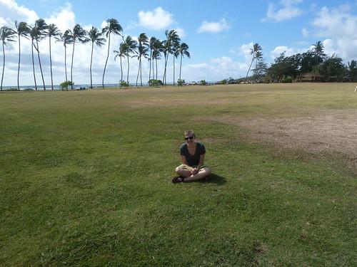 Erica rests in a field