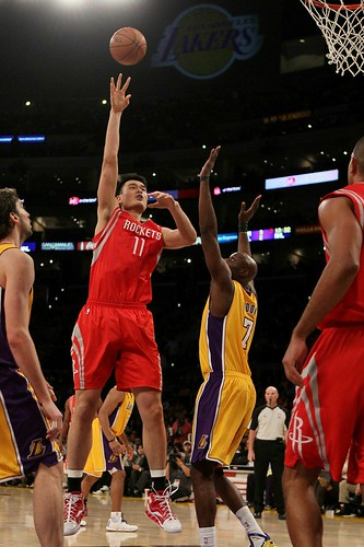 Oct. 26th, 2010 - Yao Ming shoots a jump hook over the LA Lakers' Lamar Odom
